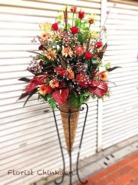 赤い花のスタンド花